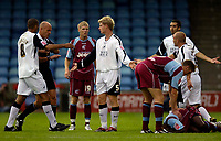 Photo: Jed Wee.<br /> Scunthorpe United v Swansea City. Coca Cola League 1. 08/08/2006.<br /> <br /> Swansea's Alan Tate (C) finds himself in big trouble after a clumsy challenge on Scunthorpe's Cleveland Taylor.