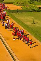 School children walking on a path at Humayun's Tomb, New Delhi, India