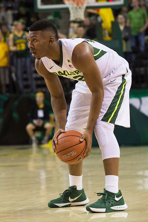 WACO, TX - JANUARY 5: King McClure #22 of the Baylor Bears brings the ball up court against the Oklahoma State Cowboys on January 5, 2016 at the Ferrell Center in Waco, Texas.  (Photo by Cooper Neill/Getty Images) *** Local Caption *** King McClure