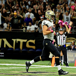 Oct 16, 2016; New Orleans, LA, USA; New Orleans Saints tight end Coby Fleener (82) scores a touchdown against the Carolina Panthers during the third quarter of a game at the Mercedes-Benz Superdome. The Saints defeated the Panthers 41-38. Mandatory Credit: Derick E. Hingle-USA TODAY Sports