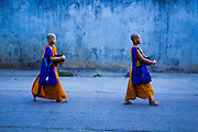 24 MAY 2013 - MAE SOT, THAILAND:   Novice Buddhist monks on their alms rounds in Mae Sot, Thailand on Visakha Puja Day, a national holiday in Thailand. Visakha Puja (Vesak) marks three important events in the Buddha's life: his birth, his attainment of enlightenment and his death. It is celebrated on the full moon of the sixth lunar month, usually in May on the Gregorian calendar. This year it is on May 24 in Thailand and Myanmar. It is celebrated throughout the Buddhist world and is considered one of the holiest Buddhist holidays.   PHOTO BY JACK KURTZ