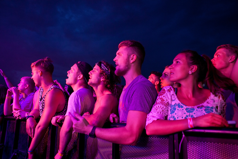 Fans wait for Young the Giant's show to start at the NewBo Music Fest in downtown Cedar Rapids on Saturday, August 8, 2015. Many of the people in the first rows of the crowd had held their places all day, waiting out clouds, rain, sun and heat to have a front-row seat to the shows. (Rebecca F. Miller/Freelance for the Gazette)
