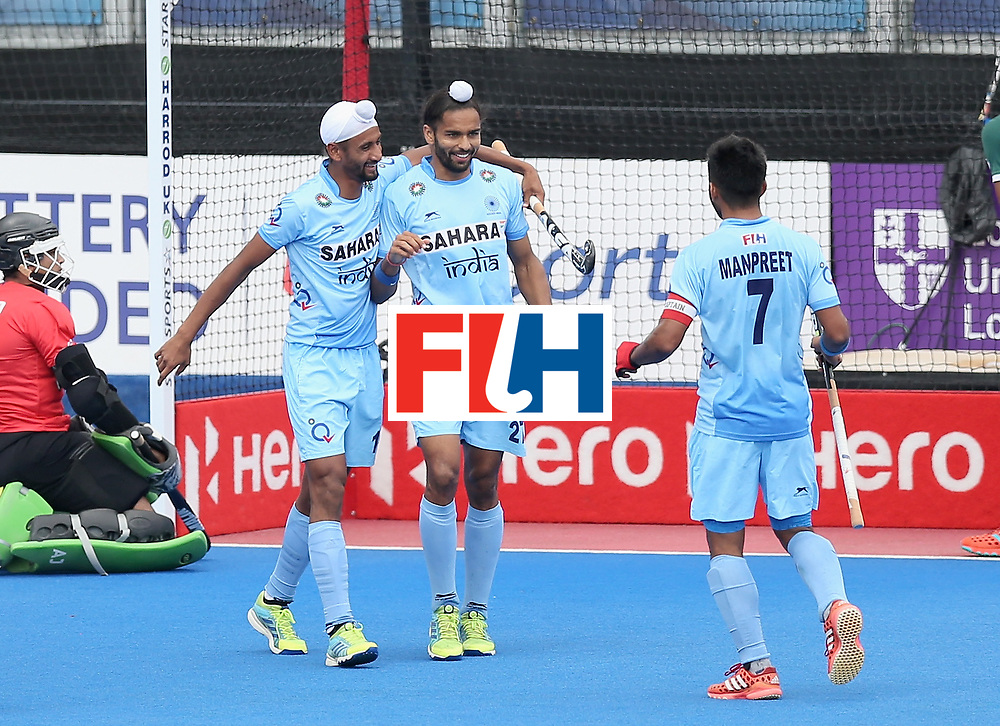 LONDON, ENGLAND - JUNE 24: Mandeep Singh of India celebrates scoring their teams third goal with teammates during the 5th-8th place match between Pakistan and India on day eight of the Hero Hockey World League Semi-Final at Lee Valley Hockey and Tennis Centre on June 24, 2017 in London, England. (Photo by Alex Morton/Getty Images)