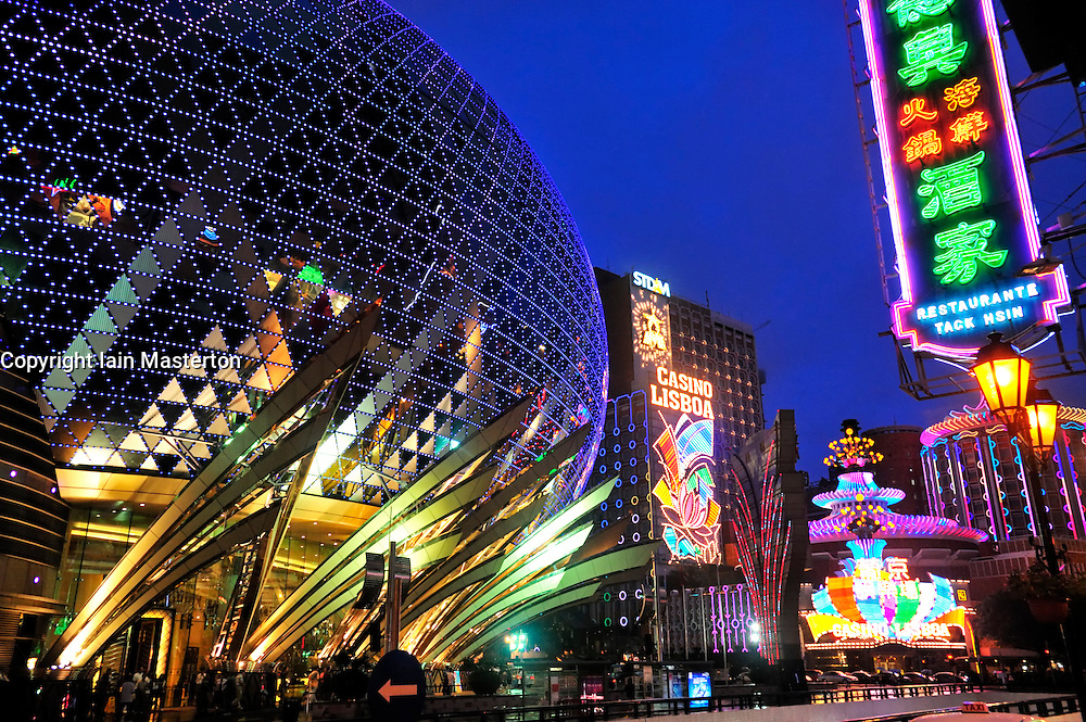 Evening view of spectacular new Grand Lisboa Casino and famous Lisboa Casino and Hotel in Macau China 2008