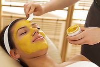 Close-up of young woman having facial mask in beauty parlor