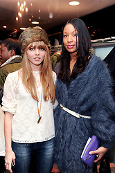 Left to right, OPHELIA LOVIBOND and SHANIKA WARREN at a party to celebrate the Firetrap Watches and Kate Moross Collaboration Launch, held at Firetrap, 21 Earlham Street, London, UK on 13th October 2010.