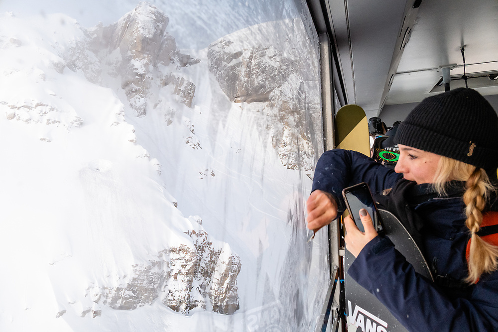 Hana Beaman scaping the frost off of the tram windows to look out at Corbet's Couloir.