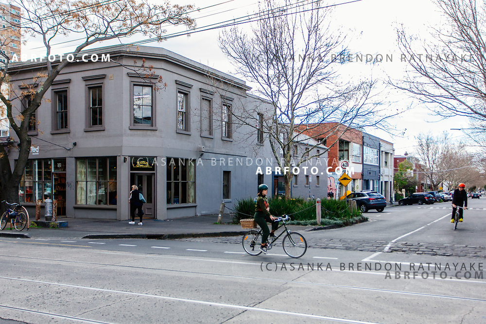 Cyclists riding their bicycles past a fine perfumery shop along Gertrude Street in Melbourne, Australia, September 1, 2017. Gertrude street which was once the urban epicentre for Aboriginals in the state of Victoria has become a gentrified suburb over the last 20 years. Asanka Brendon Ratnayake for the New York Times