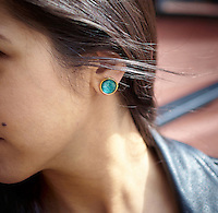 Handmade enamel jewelry by Kiln Design Studio worn by model Sona.