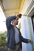 Tucson's Green Handyman, Jesse Micander, at work. He's measuring the door opening at my furnace room.