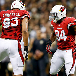 Sep 22, 2013; New Orleans, LA, USA; Arizona Cardinals outside linebacker Sam Acho (94) celebrates with defensive end Calais Campbell (93) against the New Orleans Saints during a game at Mercedes-Benz Superdome. The Saints defeated the Cardinals 31-7. Mandatory Credit: Derick E. Hingle-USA TODAY Sports
