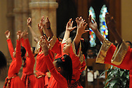 "Liturgical dancer Renisha Malik, 14, performs with fellow Chicago Catholic Schools students during the 33rd Annual African American Heritage Month Eucharistic Celebration at Holy Name Cathedral. This year's mass celebrates the the Nguzo Saba principle of Kuumba, or ""creativity"" at Holy Name Cathedral."