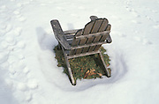wooden chair standing in the snow