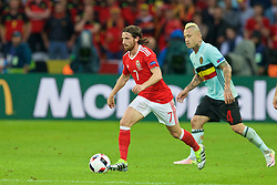 LILLE, FRANCE - Friday, July 1, 2016: Wales' Joe Allen in action against Belgium's Radja Nainggolan during the UEFA Euro 2016 Championship Quarter-Final match at the Stade Pierre Mauroy. (Pic by Paul Greenwood/Propaganda)