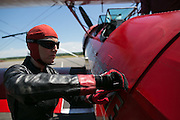 Wing walker Carol Pilon prepares before a performance at the Dunkirk Air Show in Dunkirk, New York on Saturday, July 2, 2016.