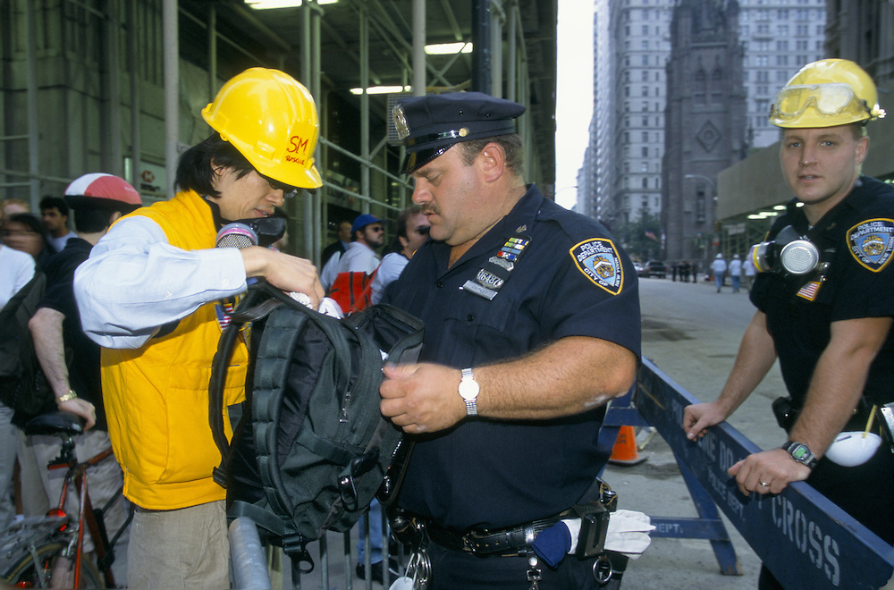 Police check backpack of clean-up volunteer before allowing access to Ground Zero, site of the terrorist attack on the World Trade Center in NYC on September 11, 2001. Photo by Lisa Quinones.