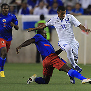 Rony Martínez, Honduras, (right), is tackled by Jean-Michel Alexandre, Haiti, during the Haiti V Honduras CONCACAF Gold Cup group B football match at Red Bull Arena, Harrison, New Jersey. USA. 8th July 2013. Photo Tim Clayton