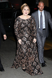 Adele Adkins greets her fans after performing at Radio City Music Hall in New York.