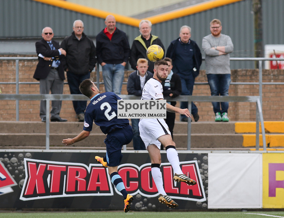 Jamie Bain is out jumped by Craig Pettigrew  during the  Forfar v Dumbarton Scottish League Cup group stage 16 July 2016<br /> <br /> (c) Andy Scott | SportPix.org.uk
