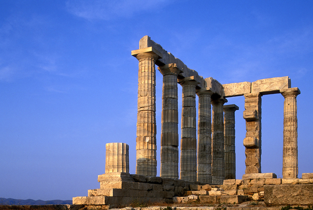 Europe, Greece, Cape Sounion, Afternoon sun lights marble columns of Temple of Poseidon south of Athens