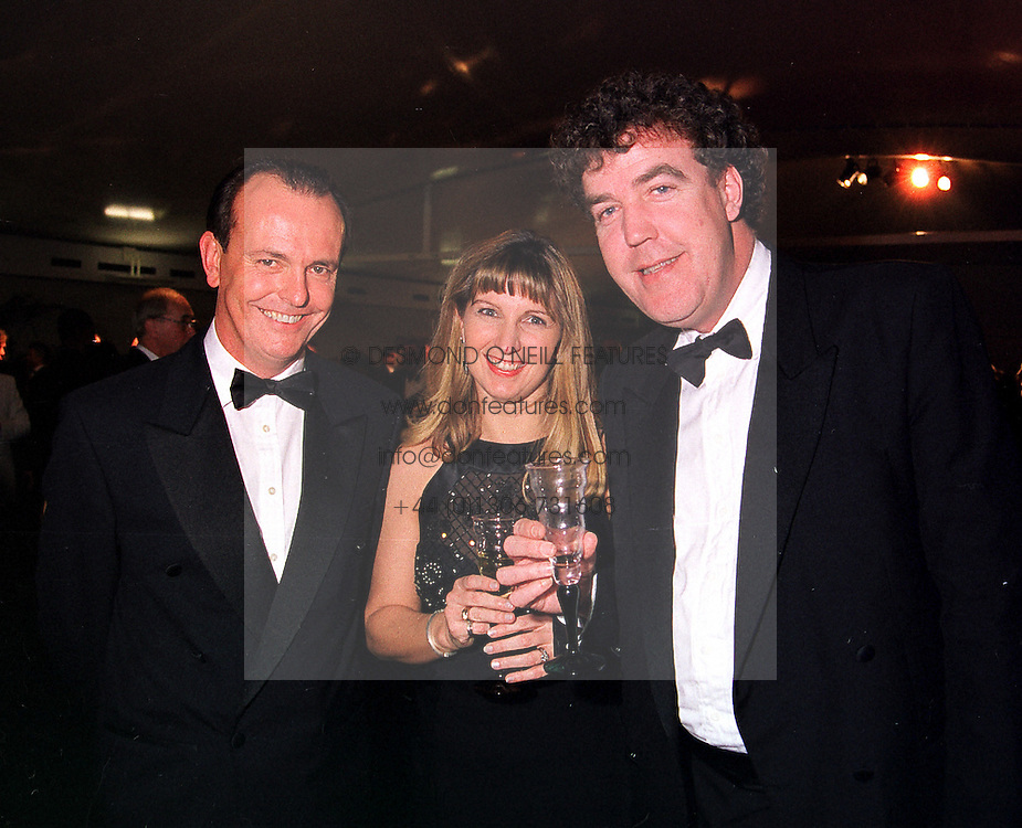 Left to right, MR & MRS QUENTIN WILSON he is the Top Gear television presenter and TV presenter JEREMY CLARKSON, at a dinner in London on 25th January 2000.OAI 68