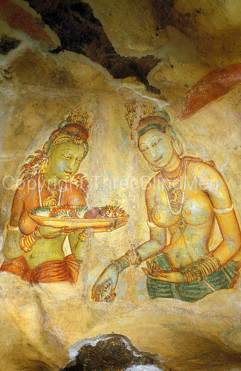 Two of the wall paintings at Sigiriya. The bare breasted maidens carry offerings of flowers.