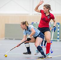  DELFT -  Mila Muyselaar (Lar)  met  Klaartje Mientjes (Nijm)   tijdens de zaalhockey competitiewedstrijd Laren-Nijmegen. COPYRIGHT KOEN SUYK