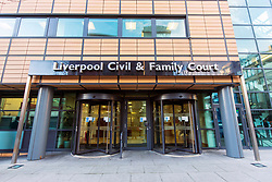 """© Licensed to London News Pictures. 02/02/2018. Liverpool UK. Picture shows Liverpool Civil & Family Court. Tom Evans and Kate James from Liverpool are in dispute with medics looking after their son 19-month-old son Alfie Evans, at Alder Hey Children's Hospital in Liverpool. Alfie is in a """"semi-vegetative state"""" and had a degenerative neurological condition doctors have not definitively diagnosed. Specialists at Alder Hey say continuing life-support treatment is not in Alfie's best interests but the boy's parents want permission to fly their son to a hospital in Rome for possible diagnosis and treatment. Photo credit: Andrew McCaren/London News Pictures"""