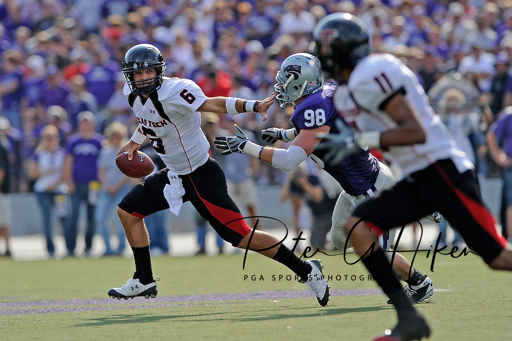 MANHATTAN, KS - OCTOBER 04:  Quarterback Graham Harrell #6 of the Texas Tech Red Raiders scrambles away from pressure from defensive end Ian Campbell #98 of the Kansas State Wildcats in the first half on October 4, 2008 at Bill Snyder Family Stadium in Manhattan, Kansas.  Texas Tech won 58-28