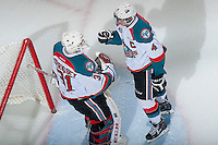 KELOWNA, CANADA - FEBRUARY 18: Madison Bowey #4 congratulates Jake Morrissey #31 of Kelowna Rockets on the win against the Kamloops Blazers on February 18, 2015 at Prospera Place in Kelowna, British Columbia, Canada.  (Photo by Marissa Baecker/Shoot the Breeze)  *** Local Caption *** Madison Bowey; Jake Morrissey;