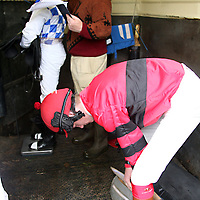 Paul Bohen gets his saddle ready as Kieran Egan weighs Leigh Roche at the annual Lisdoonvarna Races at the weekend.<br />