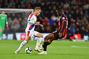 Jefferson Lerma (8) of AFC Bournemouth challenges Max Meyer (7) of Crystal Palace during the Premier League match between Bournemouth and Crystal Palace at the Vitality Stadium, Bournemouth, England on 1 October 2018.