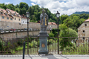 Religious sculpture on the Capuchin Bridge in Skofja Loka, on 25th June 2018, in Skofja Loka, Slovenia. The Capuchin Bridge dates back to the 14th century making it the oldest preserved bridge in Slovenia and one of the oldest monuments of this architectural style in the Middle Europe.