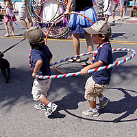 Cardiff by the Sea 100th Birthday Parade: kids in a hula hoop