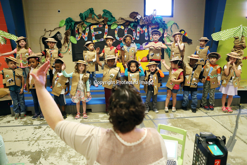 ECEC music teacher Aynsley Farmer, center, leads the students in Amanda Young's pre-k class as they rehearse their Jungle Beats performance Monday morning at the school.