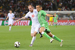 18.01.2010, Green Point Stadium, Cape Town, RSA, FIFA WM 2010, England (ENG) vs Algeria (ALG), im Bild Wayne Rooney of England tangles with Foued Kadir of Algeria. EXPA Pictures © 2010, PhotoCredit: EXPA/ IPS/ Marc Atkins / SPORTIDA PHOTO AGENCY