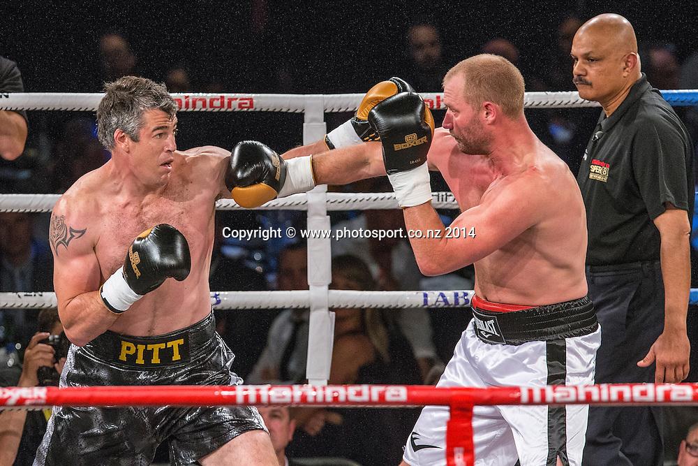 Daniel Ammann (R) fights Brad `Hollywood` Pitt in the Mahindra Super 8 Fight Night, North Shore Events Centre, Auckland, New Zealand, Saturday, November 22, 2014. Photo: David Rowland/Photosport