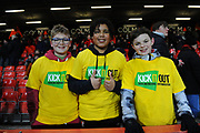 Three young fans wearing Kick It Out shirts ahead of the Premier League match between Bournemouth and Brighton and Hove Albion at the Vitality Stadium, Bournemouth, England on 21 January 2020.