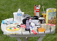 Augusta, New Jersey - A table of food, drink, and equipment for a compeitor at the 3 Days at the Fair races at Sussex County Fairgrounds on May 16, 2010. Runners needed to eat and drink during the 48-hour, 24-hour and 12-hour races.
