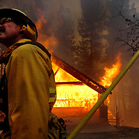 The Grass Valley Fire ravages its way into the Lake Arrowhead area of  Grass Valley Lake and The Lake Arrowhead Country Club as firefighters from all over the inland empire attack fire and defend homes, Monday, Oct. 22, 2007. Eric Reed