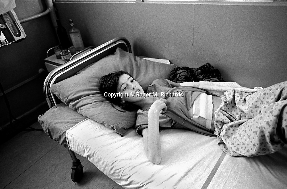 Almira Lugic, 12-years-old, lies in Kosevo Hospital with a grave stomach wound caused from a Serb shell that fell as she was collecting water, Sarajevo, Bosnia-Herzegovina, February 1993. PHOTO BY ROGER RICHARDS
