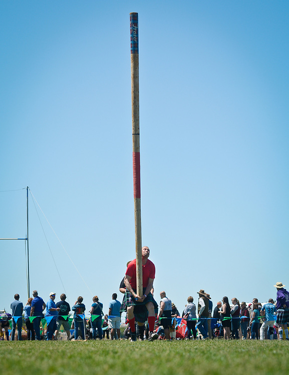 mkb052017l/metro/Marla Brose --  Frank Helme of Colorado Springs competes in the Caber Toss during the 29th Annual Rio Grande Valley Celtic Festival at Balloon Fiesta Park in Albuquerque, N.M., Saturday, May 20, 2017.  Competitors lift a pole and run forward to toss it end over end.  The event, which includes competitions, music, dancing and other Celtic traditions will continue Sunday.(Marla Brose/Albuquerque Journal)