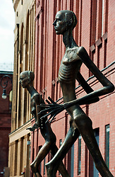 Bronze sculptures Adam and Eve by Rolf Biebl outside Kultur Brauerei cultural and entertainment center in Prenzlauer Berg Berlin Germany