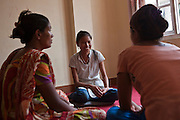 Nepalese women sit and talk in the counseling room in the Voice of Children centre in Kankeshori area of Kathmandu, Nepal.  The not-for-profit organisation supports street children and those who are at risk of sexual abuse through educational and vocational training opportunities, health services and psychosocial counseling.