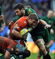 Tom Youngs of Leicester Tigers takes on the London Irish defence - Photo mandatory by-line: Patrick Khachfe/JMP - Mobile: 07966 386802 22/02/2015 - SPORT - RUGBY UNION - Reading - Madejski Stadium - London Irish v Leicester Tigers - Aviva Premiership