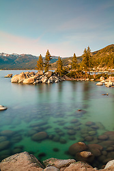 """""""Sand Harbor Sunset 4"""" - Photograph of Sand Harbor, Lake Tahoe taken just after sunset. A long exposure allowed for more light to be seen than the naked eye could see."""