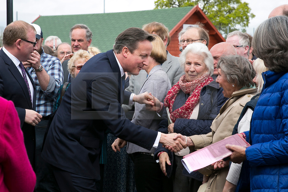 © Licensed to London News Pictures. 03/05/2015. Nuneaton, Warwickshire, UK. The Prime Minister David Cameron visited Ambleside sports club in Nuneaton, Warwickshire, earlier today. Pictured, the Prime Minister is welcomed to Nuneaton. Photo credit : Dave Warren/LNP