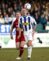 Photo: Chris Ratcliffe.<br />Colchester United v Southend United. Coca Cola League 1. 04/03/2006.<br />Freddie Eastwood (L) of Southend chases down Wayne Brown of Colchester.