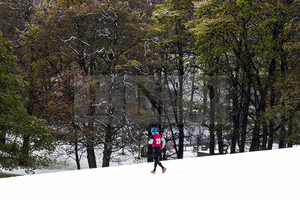 © Licensed to London News Pictures. 29/04/2016. Leeds UK. Picture shows early morning runners in the Roundhay park snow this morning. Leeds woke to a covering of snow this morning & is expected to get further snow showers over the weekend. Photo credit: Andrew McCaren/LNP