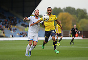 Oxford United midfielder Kemar Roofe (4) gets past AFC Wimbledon midfielder Sean Rigg (11) during the Sky Bet League 2 match between Oxford United and AFC Wimbledon at the Kassam Stadium, Oxford, England on 10 October 2015.
